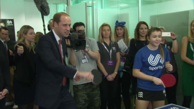 Interior shots of Prince William Duke of Cambridge Catherine Duchess of Cambridge playing doubles table tennis with young people at the ICAP offices...