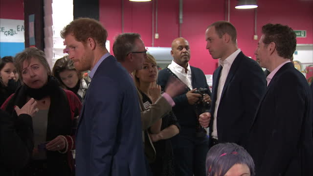 interior shots of prince william, duke of cambridge, catherine, duchess of cambridge and prince harry talking to people on their visit to the heads... - annual general meeting stock videos & royalty-free footage