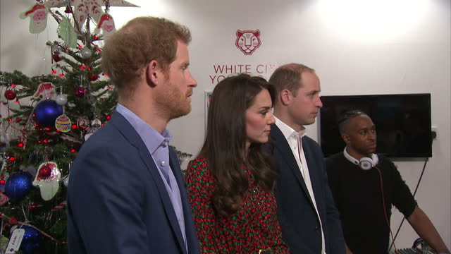 interior shots of prince william, duke of cambridge, catherine, duchess of cambridge and prince harry presenting an award to a volunteer on their... - annual general meeting stock videos & royalty-free footage