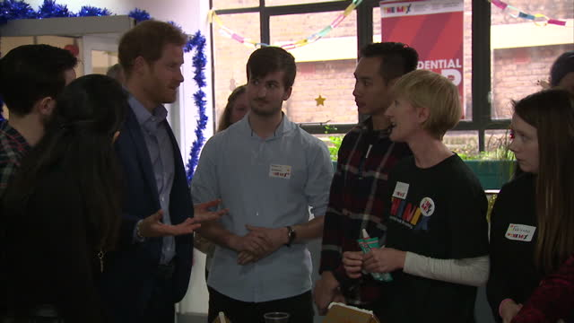 interior shots of prince william, duke of cambridge, catherine, duchess of cambridge and prince harry talking to people at christmas party whilst... - annual general meeting stock videos & royalty-free footage