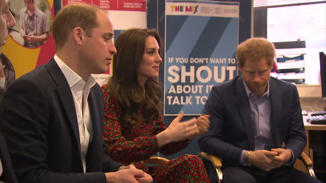 interior shots of prince william, duke of cambridge, catherine, duchess of cambridge and prince harry sitting in a group talk with volunteers on... - annual general meeting stock videos & royalty-free footage