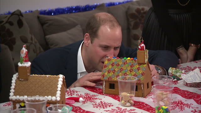 interior shots of prince william, duke of cambridge, catherine decorating gingerbread house at the heads together christmas party hosted by youth... - annual general meeting stock videos & royalty-free footage