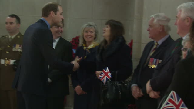 interior shots of prince william duke of cambridge meeting veterans at the unveiling of the victoria cross commemorative paving stones on december 07... - the victoria cross stock-videos und b-roll-filmmaterial