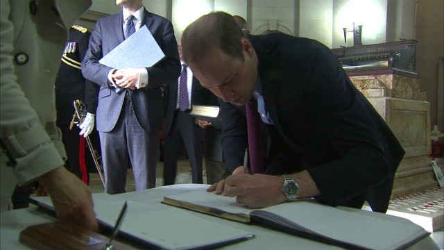 interior shots of prince william duke of cambridge signing the guest book at the unveiling of the victoria cross commemorative paving stones on... - the victoria cross stock-videos und b-roll-filmmaterial