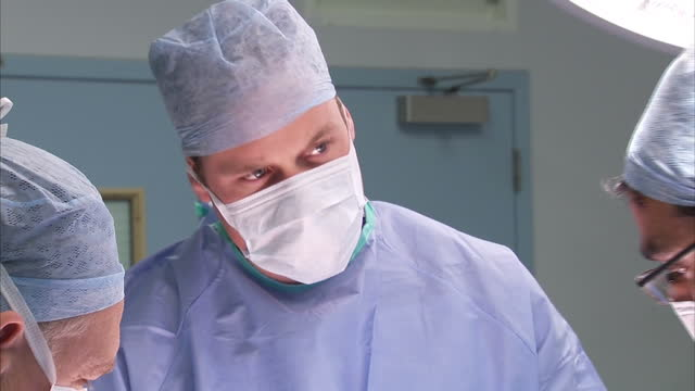 interior shots of prince william duke of cambridge wearing a surgical mask gloves and scrubs to watch an operation and speaking to surgeons during... - scrubs stock videos & royalty-free footage