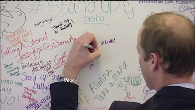 interior shots of prince william meeting youth workers at an antibullying workshop and writing a message on the facebook anti bullying week wall he... - south shields stock videos & royalty-free footage