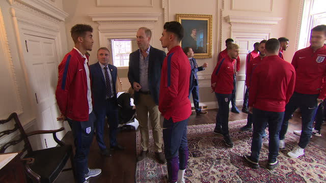 Interior shots of Prince William speaking to members of the England Under20's football team during a reception at Kensington Palace on September 07...