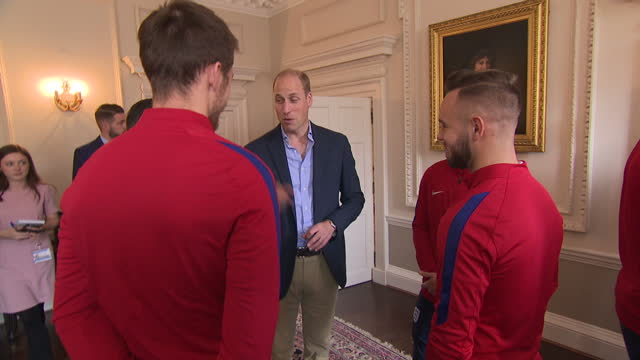 interior shots of prince william speaking to members of the england under20's football team during a reception at kensington palace on september 07... - kensington palace video stock e b–roll