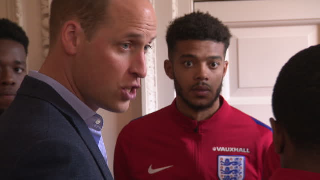 Interior shots of Prince William speaking to members of the England Under20's football team during a reception at Kensington Palace including shots...