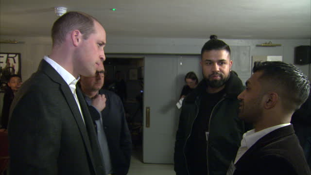 interior shots of prince william visiting the campaign against living miserably mental health charity and meeting volunteers and campaigners involved... - best man stock videos and b-roll footage
