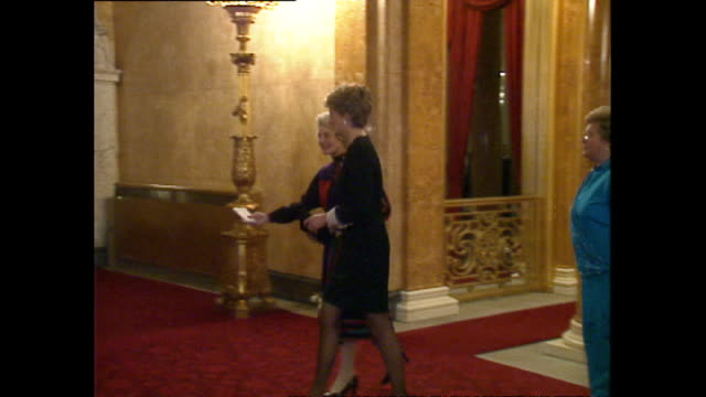 interior shots of princess diana arriving at lancaster house for the british red cross 125th birthday event on november 14, 1994 in london, england. - 黒のドレス点の映像素材/bロール