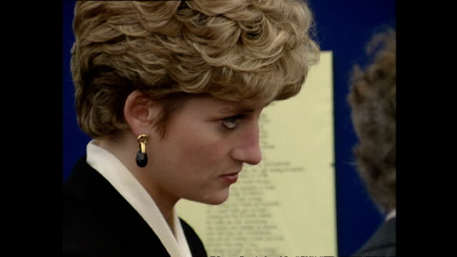Interior shots of Princess Diana attending an exhibition in Southwark with close up shots of her shoes red nail polish and earrings on October 15...