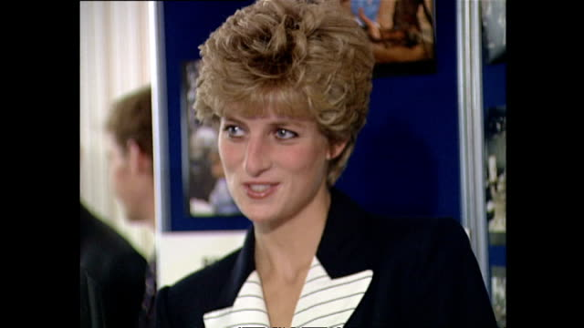 vídeos de stock, filmes e b-roll de interior shots of princess diana greeting officials and viewing exhibition on her visit to red cross headquarters on september 17 1992 in london... - 1992