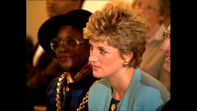 interior shots of princess diana listening to choir singing on her visit to st matthew's community centre on december 10, 1993 in london, england.... - choir stock videos & royalty-free footage