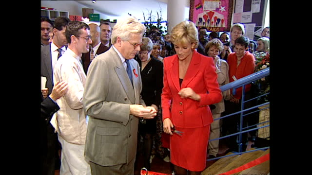 interior shots of princess diana on a visit to the london lighthouse aids charity on its 10th anniversary cutting a ribbon on 8 october 1996 in... - charity benefit stock videos & royalty-free footage