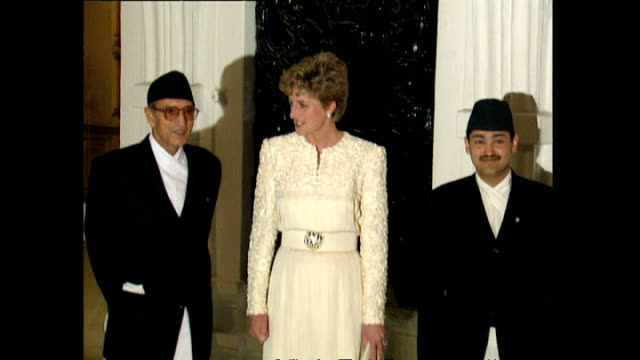 stockvideo's en b-roll-footage met interior shots of princess diana princess of wales arriving and posing for photo op with prime minister of nepal girija prasad koirala and crown... - koninklijk persoon