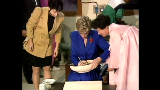 interior shots of princess diana, princess of wales, arriving at buddhist temple and visiting pottery shop and engraving bowl during royal tour on 6... - 1992 stock videos & royalty-free footage
