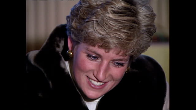 Interior shots of Princess Diana Princess of Wales chatting with army wives and their children on a visit to a British army base in Hohne on December...