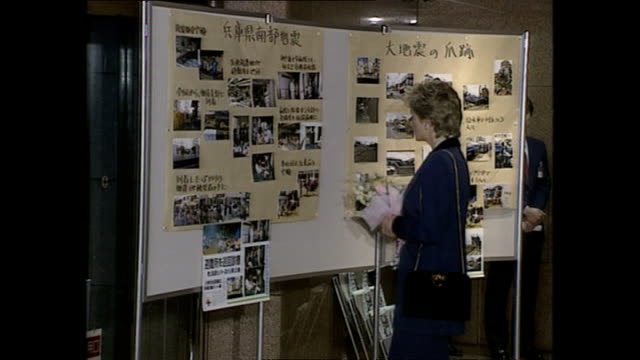 interior shots of princess diana, princess of wales, looking at boards and being shown round the red cross headquarters during royal tour on 8... - japan stock videos & royalty-free footage