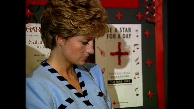interior shots of princess diana, princess of wales, looking serious and unhappy as she chats with woman at a red cross event, includes close up of... - sadness stock videos & royalty-free footage