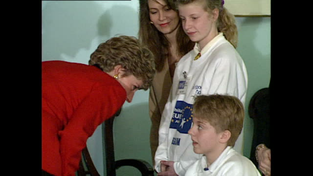 interior shots of princess diana, princess of wales meeting children as part of the children of europe awards on march 04, 1992 in london, england. - 赤のドレス点の映像素材/bロール