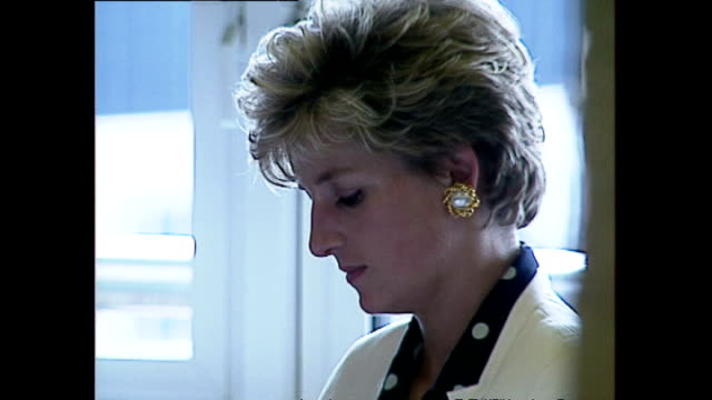 interior shots of princess diana, princess of wales, sitting at table in the qeii building listening to speech looking serious and at times sad. on... - relationship difficulties stock videos & royalty-free footage