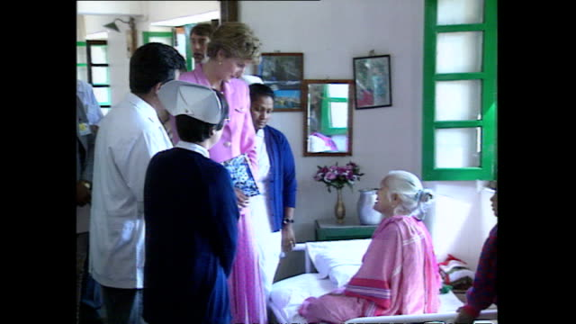 interior shots of princess diana princess of wales visiting anandaban hospital speaking to doctors and meeting leprosy patients during her royal... - visit stock videos and b-roll footage