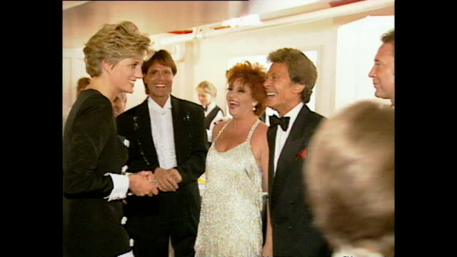 interior shots of princess diana princess of wales walking into room and greet celebrities including cliff richard lionel blair tom jones joan... - cliff richard stock videos and b-roll footage