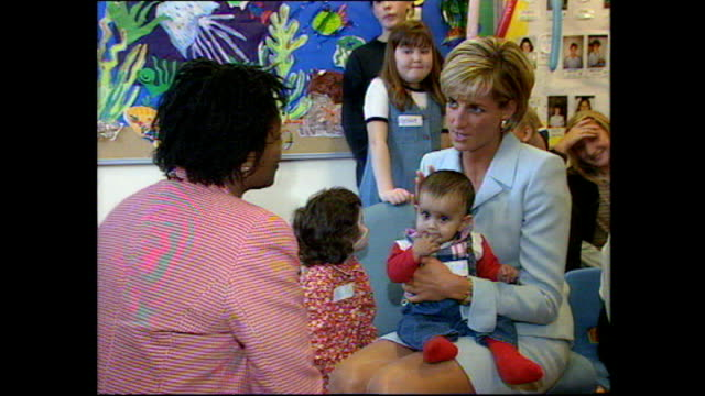 Interior shots of Princess Diana sitting with sick children posing for photos and holding a baby on her visit to Royal Brompton Hospital on April 15...