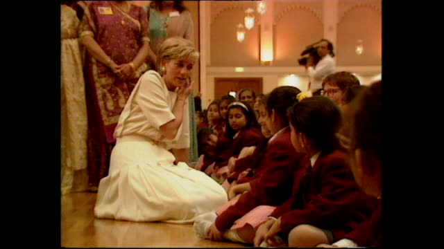Interior shots of Princess Diana talking to children whilst sitting on the floor on her visit to Shri Swaminarayan Mandir Hindu Temple on June 06...