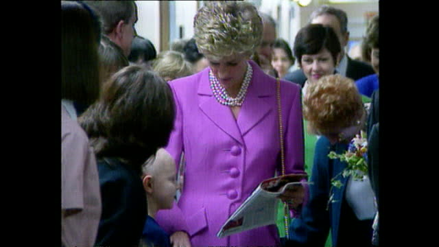 Interior shots of Princess Diana talking to sick children on her visit to Great Ormond Street Hospital on February 14 1994 in London England