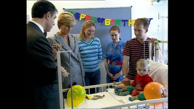 Interior shots of Princess Diana visiting a sick child and his parents at a paediatric ward in St Mary's Hospital on April 22 1997 in London England