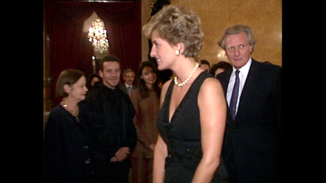 vídeos de stock e filmes b-roll de interior shots of princess diana walking into room with michael heseltine and greet officials during fashion week at lancaster house on october 07,... - vestido preto