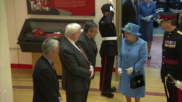 interior shots of queen elizabeth arriving and greeting officials at the millennium stadium.>> on june 11, 2015 in cardiff, wales. - 2015 stock videos & royalty-free footage