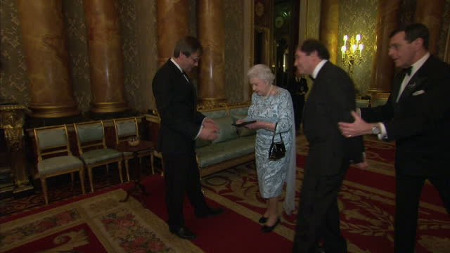 interior shots of queen elizabeth ii accompanied by lord berkley speaking to simon halsey winner of the 2014 queen's medal for music>> on march 11... - london symphony orchestra stock videos & royalty-free footage