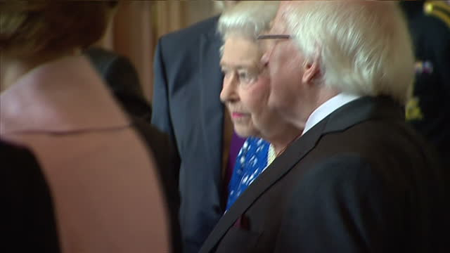 interior shots of queen elizabeth ii and irish president michael d higgins entering hall and greeting people on april 10 2014 in london england - michael d. higgins stock videos and b-roll footage