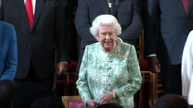 Interior shots of Queen Elizabeth II and members of the Royal Family including Prince Charles Prince Harry Prince William and Princess Anne entering...