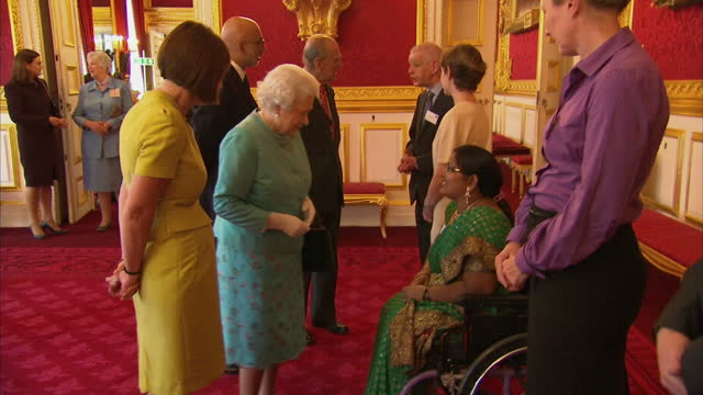 interior shots of queen elizabeth ii and prince philip duke of edinburgh meeting people at a reception being held at st james' palace for leonard... - botschafter stock-videos und b-roll-filmmaterial
