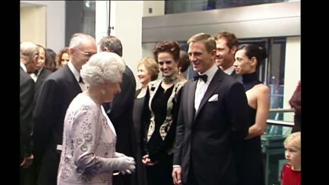 stockvideo's en b-roll-footage met interior shots of queen elizabeth ii and prince philip duke of edinburgh meeting the cast of casino royale including daniel craig judi dench eva... - première