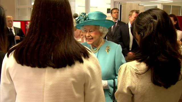 interior shots of queen elizabeth ii and prince philip speaking to members of chadwell community centre, prince philip makes a joke 'oh so you sponge... - queen's birthday stock videos & royalty-free footage