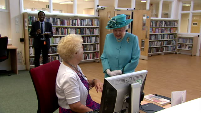 interior shots of queen elizabeth ii and prince philip two elderley members of the public who are using the computers at chadwell heath community... - queen's birthday stock videos & royalty-free footage
