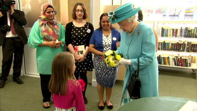 interior shots of queen elizabeth ii being given flowers by a young girl and looking at a picture of a corgi that she drew. on july 16, 2015 in... - pure bred dog stock videos & royalty-free footage