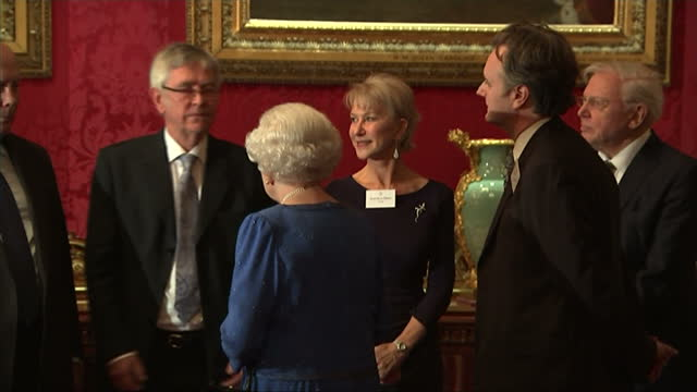 interior shots of queen elizabeth ii greeting guests at a reception to celebrate the performing arts in the uk, including dame helen mirren and... - julian fellowes stock videos & royalty-free footage