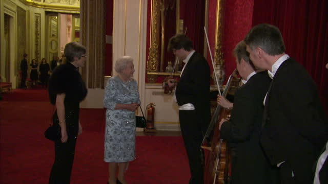 interior shots of queen elizabeth ii meeting members of the london symphony orchestra during a reception to mark the conclusion of the 'moving music'... - london symphony orchestra stock videos & royalty-free footage