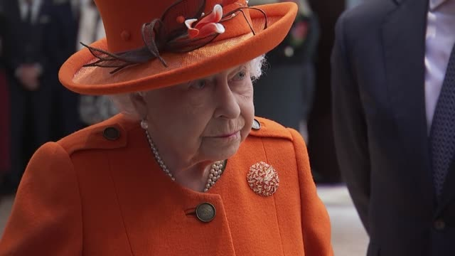 interior shots of queen elizabeth ii meeting museum staff and being shown an enigma code breaking machine also a painting by terence cuneo depicting... - enigma machine stock videos & royalty-free footage