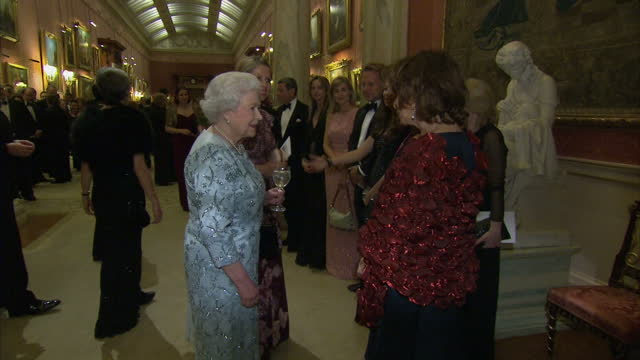 interior shots of queen elizabeth ii meeting various musicians and guests at a reception to mark the end of the 'moving music' campaign>> on march 11... - london symphony orchestra stock videos & royalty-free footage