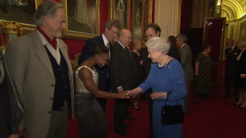 interior shots of queen elizabeth ii speaking to guests including dame helen mirren, julian fellowes, hugh laurie and trevor eve.>> on february 17,... - hugh laurie stock videos & royalty-free footage