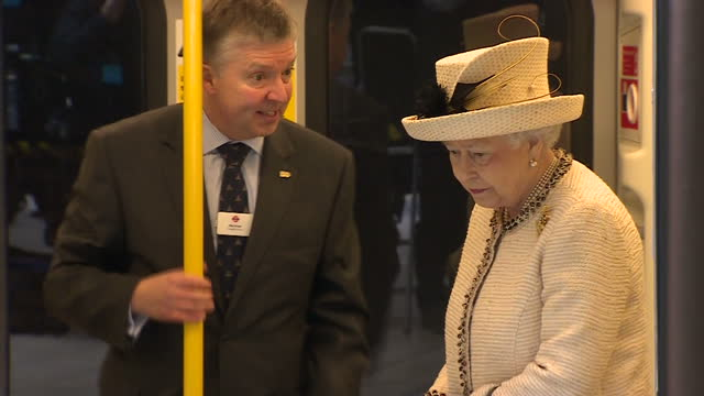 Interior shots of Queen Elizabeth II walking through London Underground tube carriage being given a tour by TFL worker Royals visit Baker Street Tube...