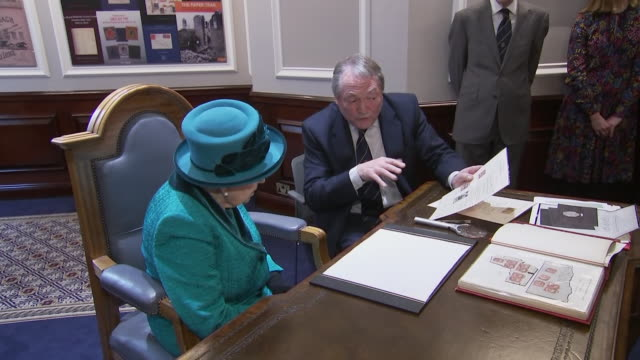 interior shots of queen elizabeth meeting staff and patrons and being shown a book that was donated by her grandfather at the opening of the royal... - arts culture and entertainment stock videos & royalty-free footage
