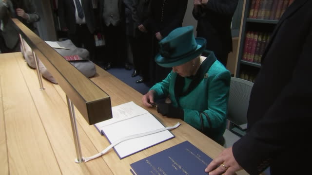 interior shots of queen elizabeth meeting staff and patrons signing a book and being gifted a book in return at the royal philatelic society on 26... - arts culture and entertainment stock videos & royalty-free footage